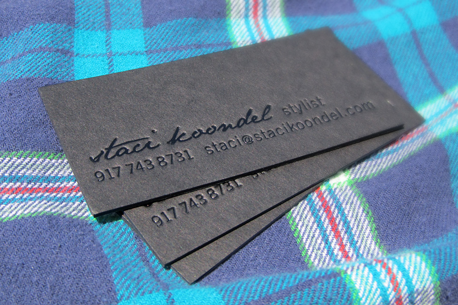 Letterpress and black foil stamp business card on black museum board